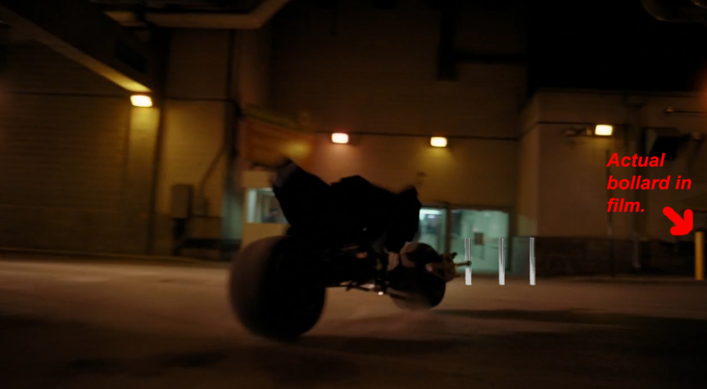 Batman driving through building in Dark Knight